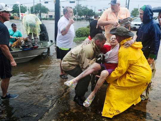 Neighbors used their personal boats to rescue Jane