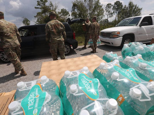 Oak Park, a mobile home park in Alva, Florida got hit hard by Hurricane Irma. Homes were severely damaged or destroyed.  Photographed on Thursday 9/14/2017.  The National Guard is handing out water and rations at several distribution sites throughout the area. This one was off of Joel Boulevard in Lehigh Acres, Florida.
