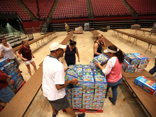 FSU employees prepares donated goods Thursday for a