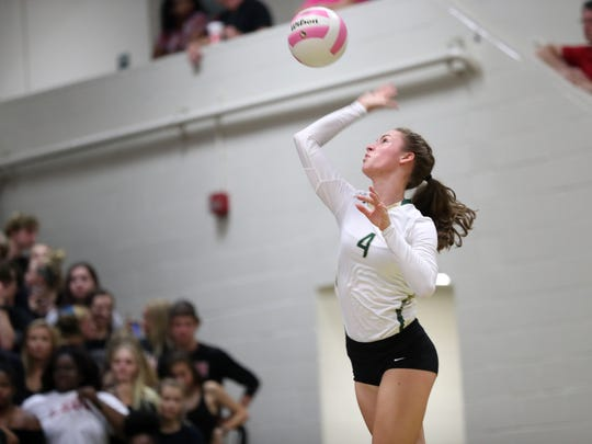Lincoln's Kaylyn Buchanan serves the ball during their match against Leon at Lincoln High School on Thursday.
