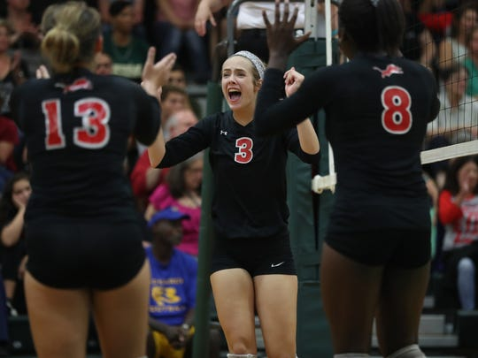 Leon celebrates a point during their match against the Trojans at Lincoln High School on Thursday.