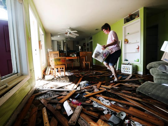 Jeanne Blaney, a resident of Shady River Lane off of the Orange River in Buckingham, Florida removes personal items after her home was flooded from water associated with Hurricane Irma. She and her family rode out the storm in the home and had to evacuate as flood waters rose around them as the storm passed by. Many homes along the road were flooded in storm.