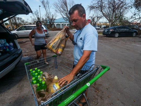 Mark and Angie Mundy load up groceries from Public after returning from Port St. Lucie to Marathon to find their 48-foot boat, on which they lived, survived the storm but caught on fire after when its generator short circuited.  They are now staying on a friendÕs boat and donÕt plan to leave the Keys. ÒThis is still paradise,Ó Angie Mundy said. As of Sunday morning all roads into the Keys will be open for Residents. Saturday morning Roads were open through Marathon, making a lot of people happy.