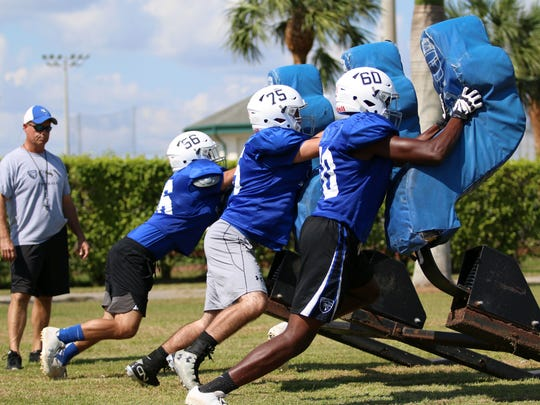 Players run through blocking drills during Community School's first practice back after Hurricane Irma shut down schools and cancelled games for weeks. The Seahawks are slated to be one of four area teams to play on Friday night when they face Moore Haven in a conference game.