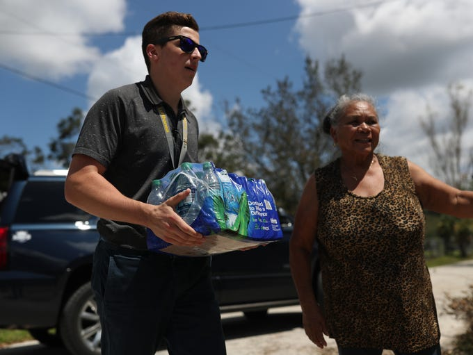 Pilot Dylan Leoni helps to hand deliver supplies, including