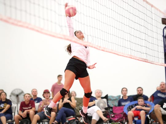 NFC's Chloe Culp spikes the ball during their match against Community Christian at the ProStyle Volleyball Academy on Tuesday.