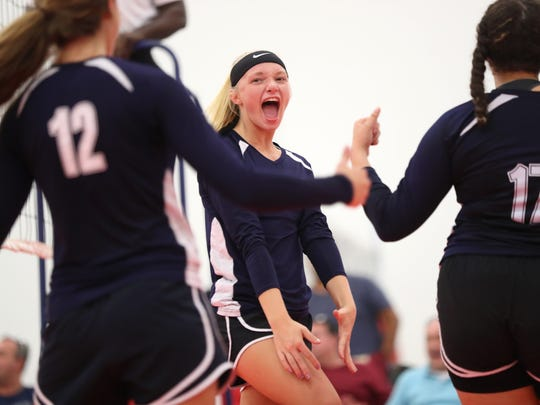 Community Christian's Sarah Banks celebrates a point with her teammates during their match against NFC at the ProStyle Volleyball Academy on Tuesday.