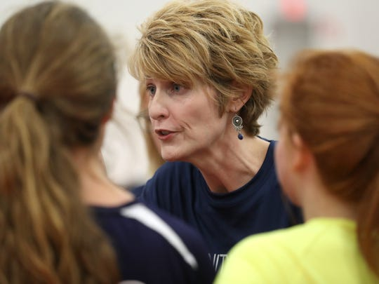 Community Christian Head Coach Nina Gunn-Hall talks to her team on the sidelines during their match against NFC at the ProStyle Volleyball Academy on Tuesday.