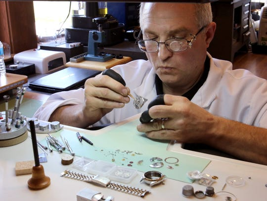 Jeff Forslung places the movment from a Rolex wrist