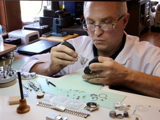 Jeff Forslung places the movment from a Rolex wrist watch into a service mount as he continues with cleaning and repair of the 26-jewel mechanical watch at Lake Country Jewelers in Pewaukee.