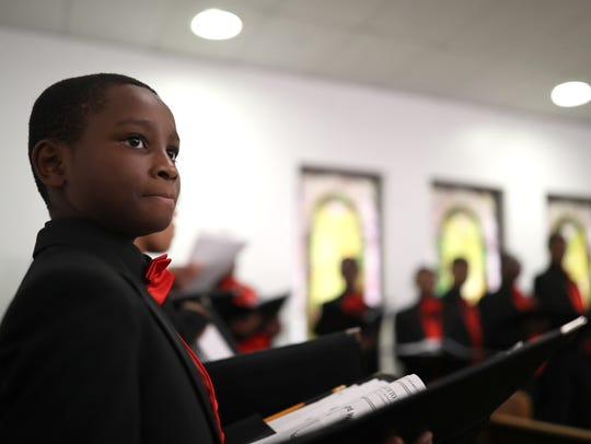 William Davis, 12, practices with the Boys' Choir of