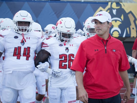 Austin Peay coach Will Healy stands with his team during