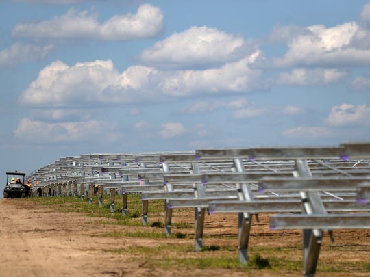 Crews from Blattner Energy inspect the framework for a 20 megawatt, 120-acre solar farm on the border of Tallahassee International Airport on Tuesday, Sept. 26, 2017.