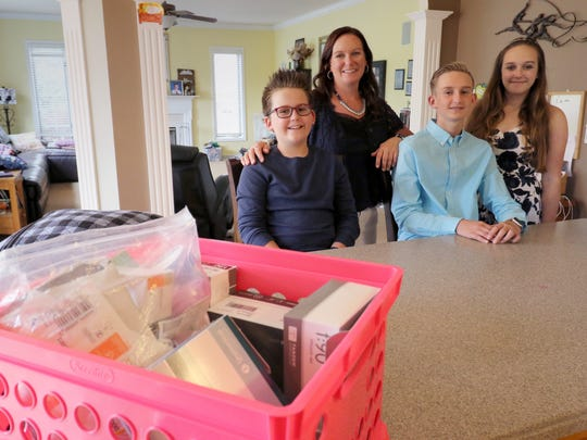 Corinne Merton and children Brayden, 10, Jacob, 13, Grace, 14, at their Hartland home. All of the Merton children are living with Type 1 Diabetes.