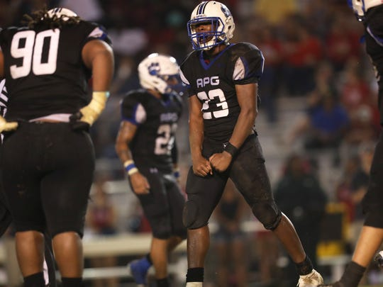 Godby's Tarian Lee Jr. celebrates a tackle against Wakulla during their game at Cox Stadium on Friday.