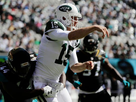 New York Jets quarterback Josh McCown looks to throw