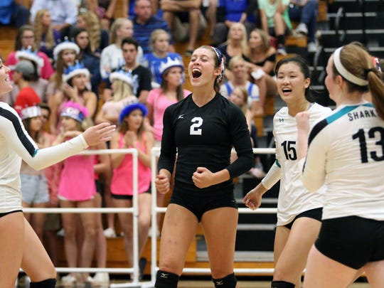 The Gulf Coast volleyball team celebrates a point during the rematch of the Barron Collier versus Gulf Coast crosstown rivalry match at Gulf Coast on Wednesday, Oct. 4, 2017.