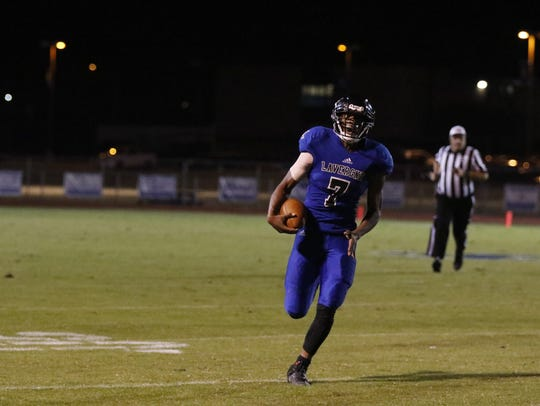 La Vergne running back Montez Gray runs for some of