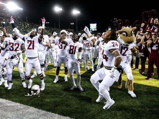 Washington State celebrates their 33-10 victory over Oregon in an NCAA college football game Saturday, Oct. 7, 2017 in Eugene, Ore. (AP Photo/Thomas Boyd)