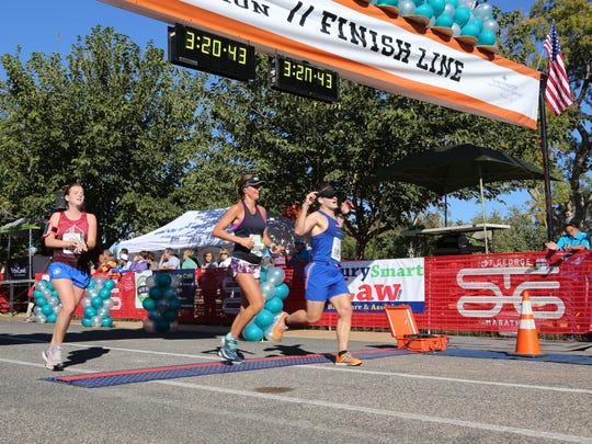 Racers cross the finish line at the 2017 St. George Marathon.