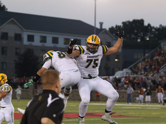 Sidney graduate Austin Dean was named the Empire 8 Conference's Defensive Player of the Year for Brockport.