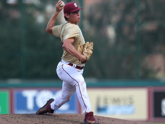 FSU's Tyler Holton pitches during their garnet and