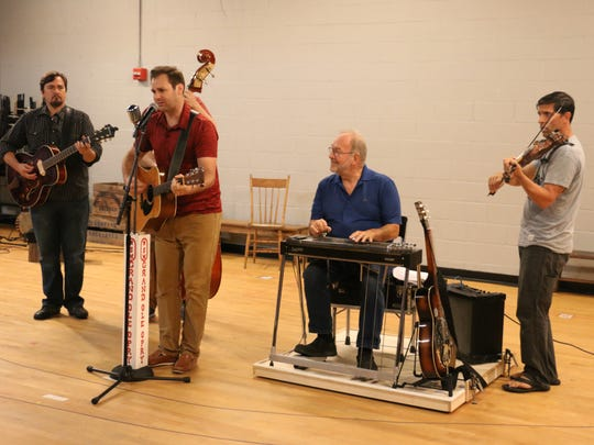 Ben Hope (starring as Hank Williams) rehearses with band members Eric Anthony (Jimmy Burrhead), Roger Rettig (as Shag), David Finch (as Leon Loudmouth).
