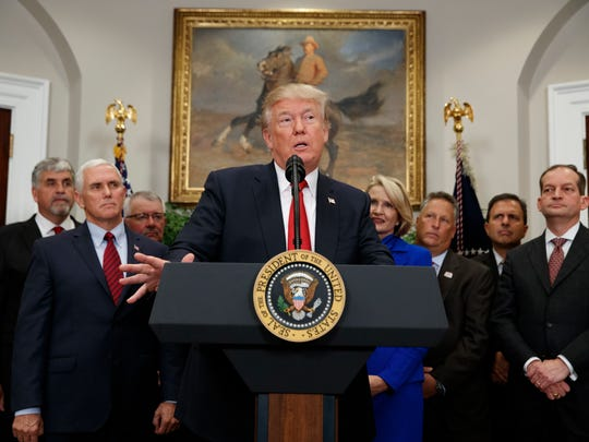President Donald Trump speaks before signing an executive order on health care in the Roosevelt Room of the White House, Thursday, Oct. 12, 2017, in Washington.