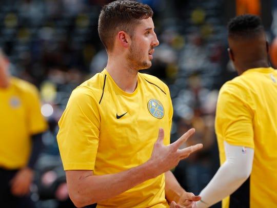 Denver Nuggets forward Tyler Lydon warms up for a preseason