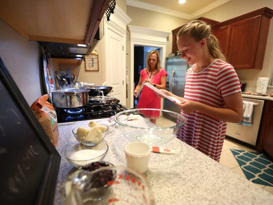 Lily Jones, 12, prepares banana blueberry muffins with