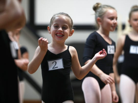 Willow Willis, 6, smiles during an audition for the