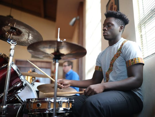 Elorm Dzikunu, who has been playing drums at the church