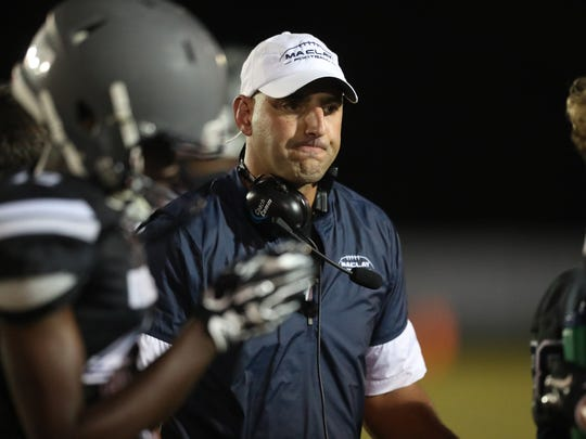 Maclay Head Coach Lance Ramer takes a timeout against FAMU DRS during their game at Maclay school on Friday, Oct. 20, 2017.