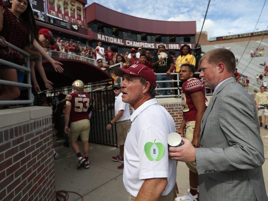 Florida State head coach Jimbo Fisher reacts to a fan after Saturday's 31-28 loss to Louisville at Doak Campbell Stadium.