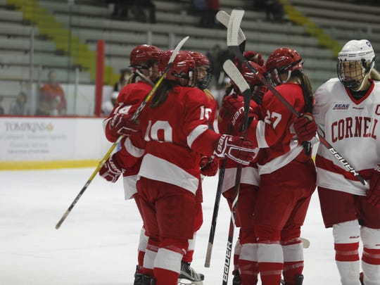 The red team celebrates a goal during the Red-White