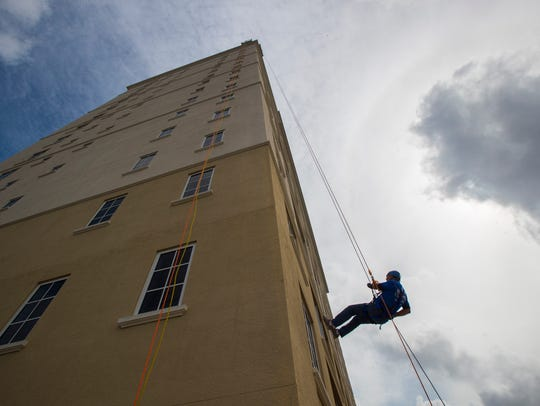 Robb Smith rappels down the side of the 19 story Westin Cape Coral Resort at Marina Village tower Sunday, October 22. The event was done in conjunction with the non-profit group Over The Edge, as a fundraiser for the Heights Foundation.