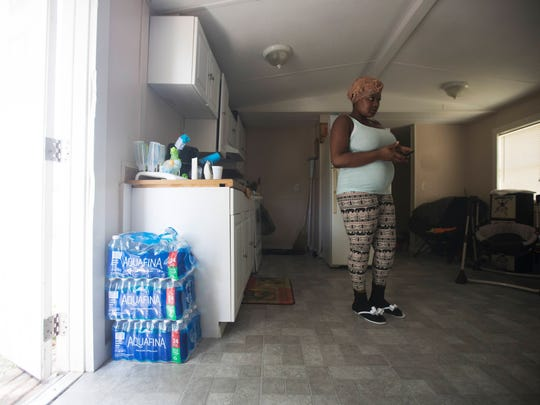 Raven Adams took her infant son to doctor because he developed dry spots on his legs. They told her to use more purified water to bathe him, even though she had boiled the well water from the Charleston Park trailer. She pays acquaintances for rides to a convenience store to get bottled water.