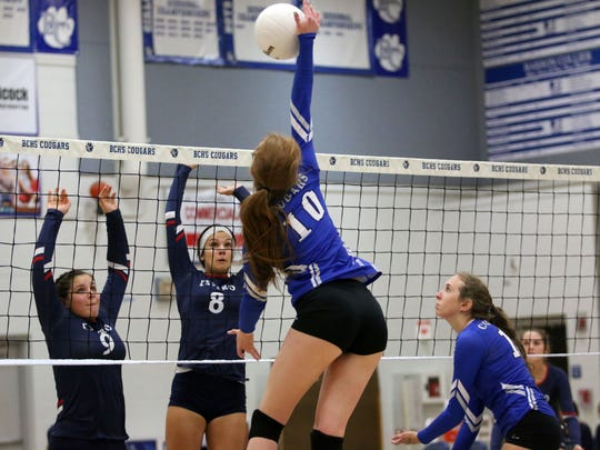 Barron Collier's Shey Kirwin hits the ball during the Class 7A regional quarterfinal between the Cougars and Estero at Barron Collier High School on Wednesday, Oct. 25, 2017.