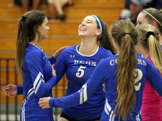 The Barron Collier volleyball team celebrates a point during the Class 7A regional quarterfinal between the Cougars and Estero at Barron Collier High School on Wednesday, Oct. 25, 2017.