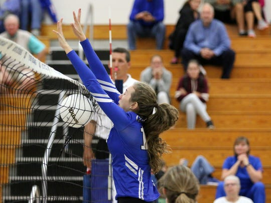 Barron Collier's Hannah Alfes blocks an attack during the Class 7A regional quarterfinal between the Cougars and Estero at Barron Collier High School on Wednesday, Oct. 25, 2017.