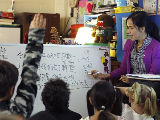 Yu Qiu teaches her fourth-grade class, Monday, Oct.
