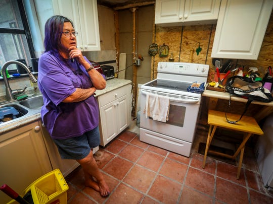 Marcia and Mike Denius woke up the night after Hurricane Irma with water squishing under their feet. They only had a few minutes to escape their home. Marcia stands in her kitchen that is having to be renovated due to water damage. Residents along Bedman Creek were flooded during Hurricane Irma, but they feel like the flooding was man made and not because of the storm.