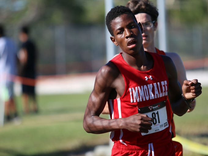Runners compete in the Class 2A-12 district meet at
