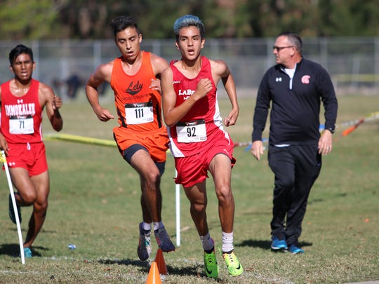 LaBelle's Bo Campbell holds on to the lead on the final lap of the Class 2A-12 district meet at Lely High School on Friday, Oct. 27, 2017.