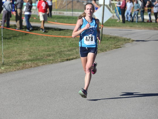 Siegel's Rachel Strayer captured first in the girls division and helped the Lady Stars take second overall at the Region 4 cross country meet Thursday.
