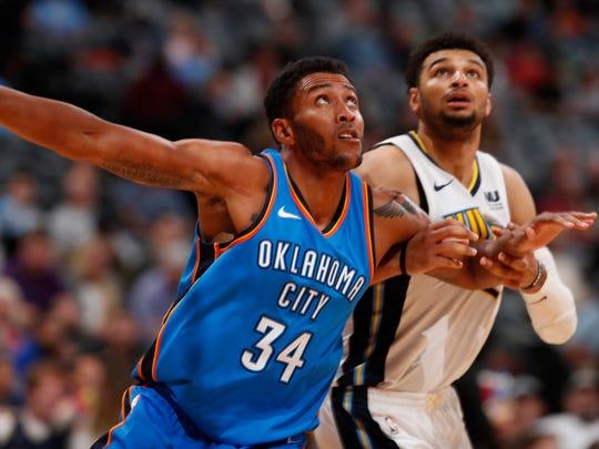 Oklahoma City Thunder forward Josh Huestis (34) and Denver Nuggets guard Jamal Murray (27) in the second half of an NBA preseason basketball game Tuesday, Oct. 10, 2017, in Denver. The Thunder won 96-86. (AP Photo/David Zalubowski)