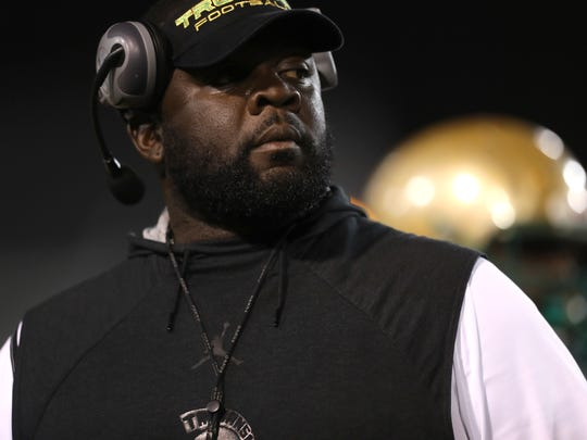 Lincoln Head Coach Quinn Gray watches his team from the sidelines as they take on Godby at Cox Stadium on Friday.