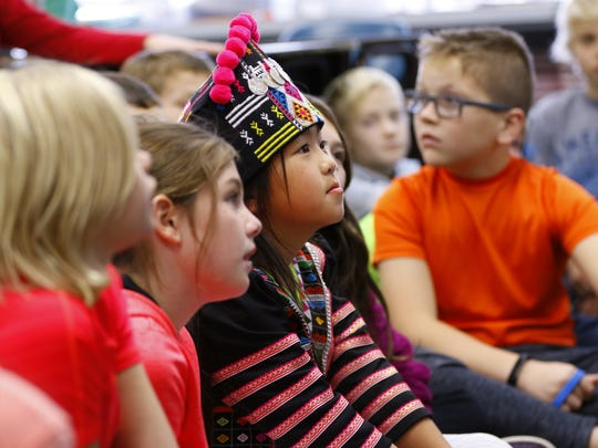 Riverside Elementary School in Ringle celebrates Hmong new year on Friday, Nov. 3, 2017, prior to the two-day Wausau Hmong New Year event set to be held Saturday and Sunday, Nov. 4 and 5, at the Greenheck Field House in Weston, Wis.