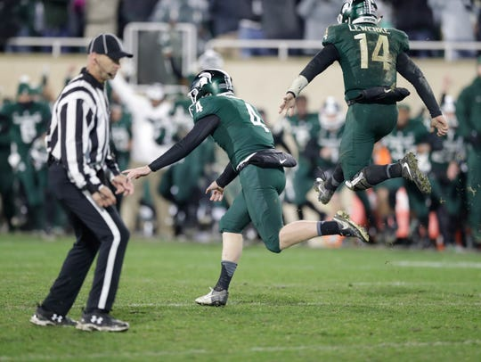 Michigan State place kicker Matt Coghlin (4) and holder