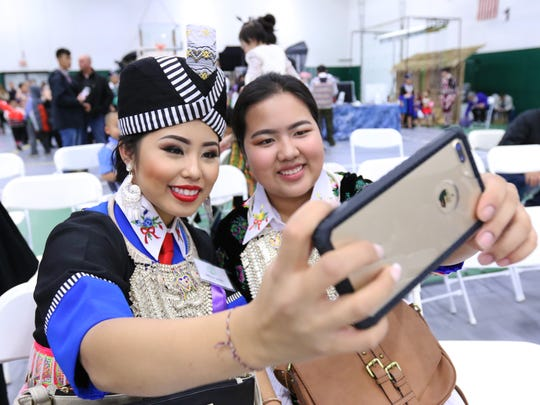 Molly Vang, left, and Kalia Chang, both of Weston, take selfie during Saturday's Wausau Hmong New Year celebration, Nov. 4, 2017, at the Greenheck Field House in Weston, Wis. T'xer Zhon Kha/USA TODAY NETWORK-Wisconsin
